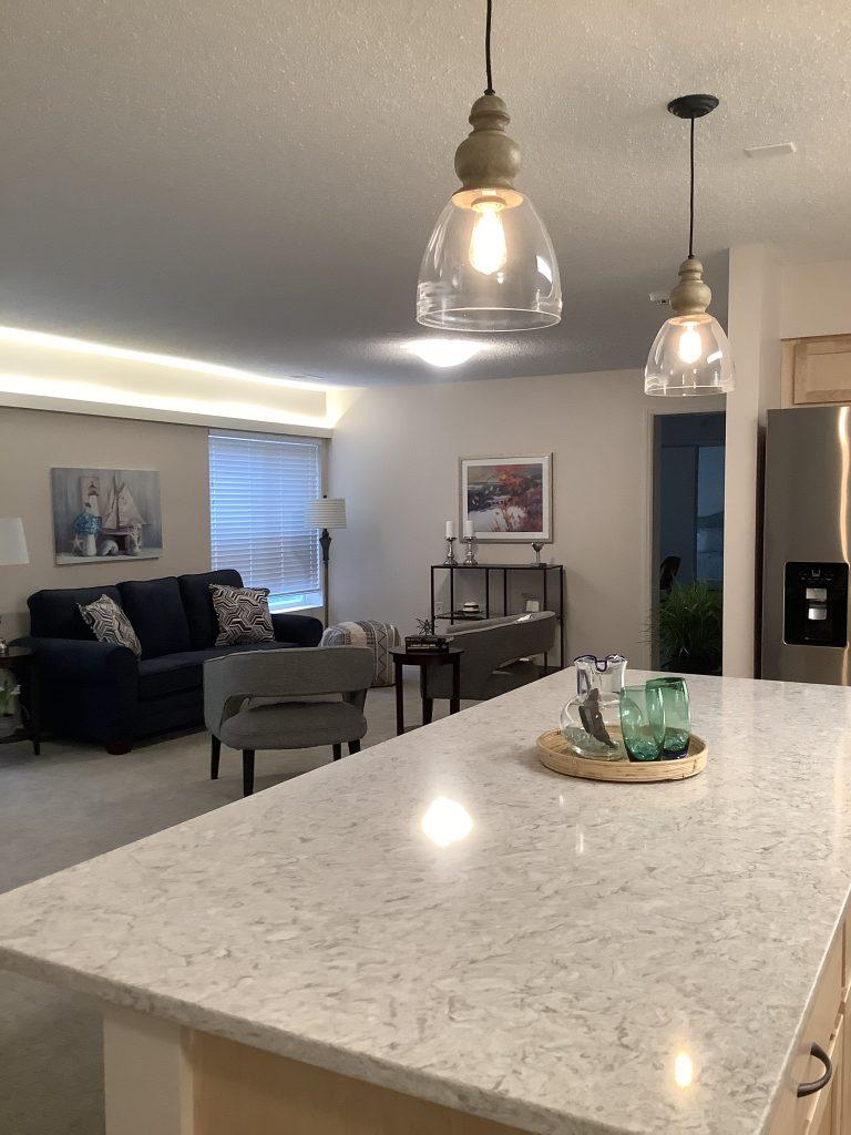 109A Kitchen Island and Living 2020 | Middleton Glen Independent Living Retirement Community